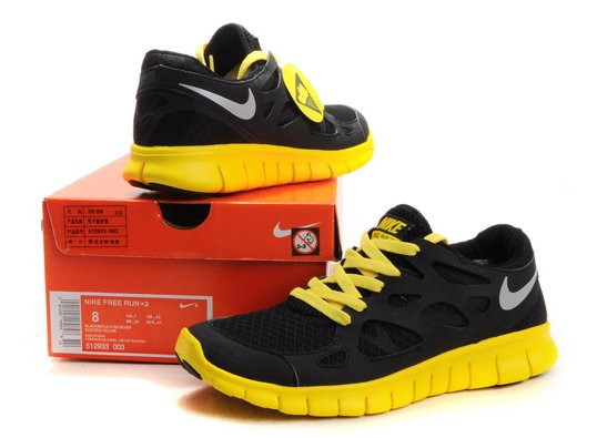 black and yellow nike shoes