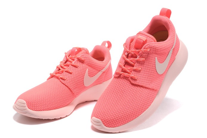 2f4b8397c362 pink nike running shoes